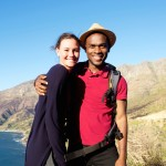 Portrait of affectionate young couple on summer vacation standing together outdoors on a mountain