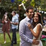 Portrait Of Couple Celebrating Wedding With Backyard Party