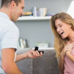 photodune-8461357-man-on-one-knee-proposing-to-surprised-girlfriend-in-sitting-room-at-home-xxl-(1)