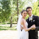 Portrait of loving young newly wed couple dancing together in garden
